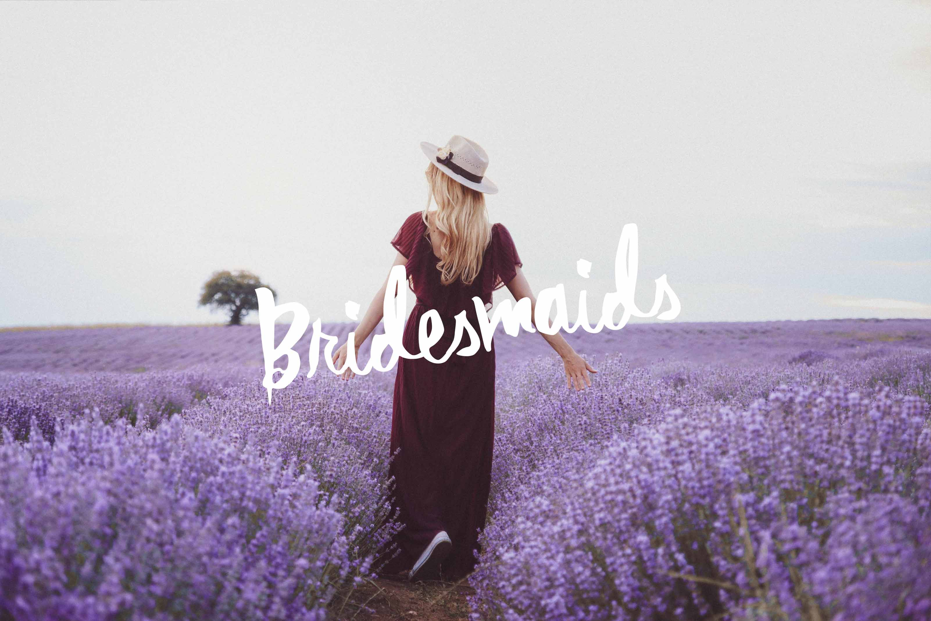 Girl with long pleated bordo dress amid lavenders. Fashion